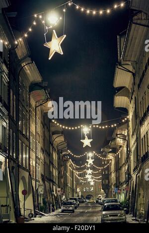 Night time view of christmas star lights in street, Lausanne, Switzerland - Stock Photo