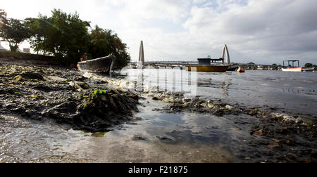 Rio de Janeiro,Brazil- March 03rd 2015- Garbage floats in a polluted beach at the Guanabara bay, where the sailing - Stock Photo