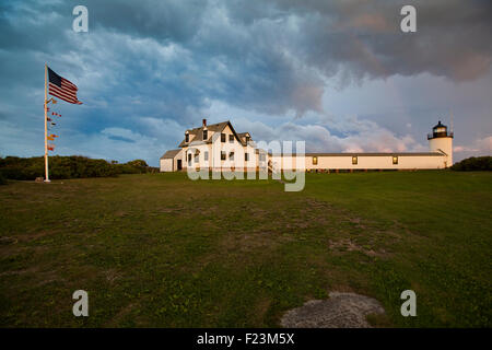 Goat Island Lighthouse bathed in evening light with storm clouds blowing over - Stock Photo