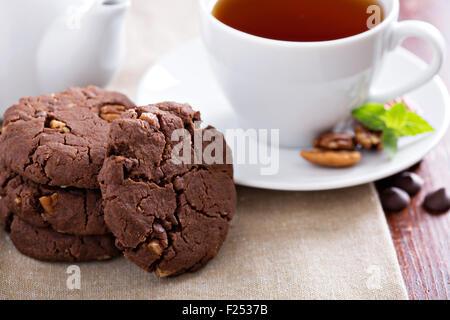 Vegan chocolate pecan cookies on the table - Stock Photo