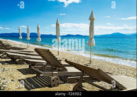 Beach with empty sunbeds on Pelion Peninsula, Thessaly, Greece - Stock Photo
