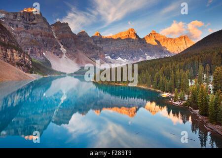 Beautiful Moraine Lake in Banff National Park, Canada. Photographed at sunrise. - Stock Photo