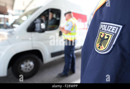 Members of the German Federal Police inspect a vehicle at a border checkpoint between Germany and Switzerland on - Stock Photo