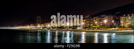 Copacabana Beach panorama by night, in Rio de Janeiro, Brazil - Stock Photo