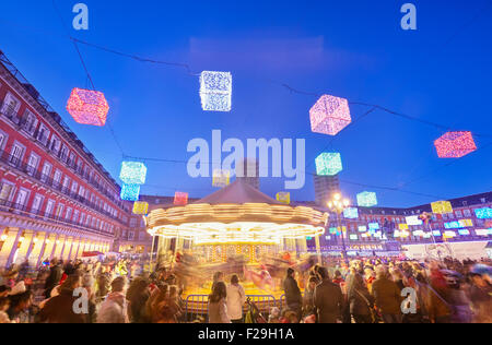 Carousel at Christmas market in Plaza Mayor. Madrid, Spain. - Stock Photo