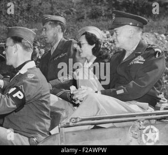 Kay Summersby seated between Generals Eisenhower and Mark Clark in a Jeep. They were in Germany, passing the ruins - Stock Photo