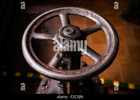 old handwheel of valve - Stock Photo