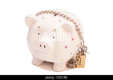 Piggy bank padlocked with chains and padlock on white background - Stock Photo