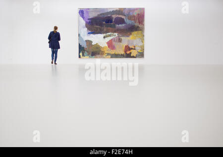Hanover, Germany. 17th Sep, 2015. A woman stands in front of an art work by Per Kirkeby, which is part of the exhibition - Stock Photo