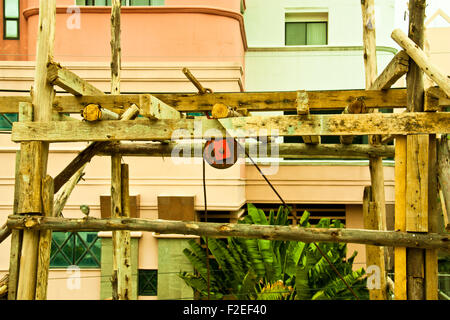 Pulley suspended on a wood frame construction. - Stock Photo