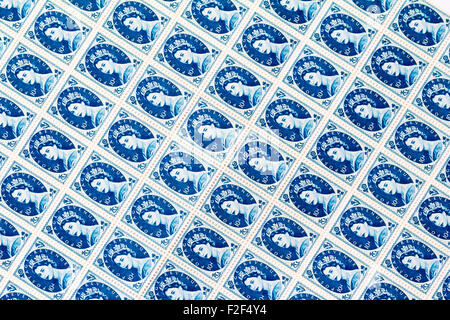 Sheet of 1950's British Royal Mail 10d blue postage stamps from the Wildings definitive issue with portrait of Queen - Stock Photo