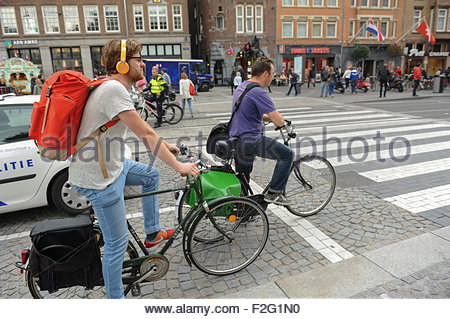 Amsterdam The Netherlands. Cyclists stop at a red light on a zebra crossing devoid of people. An unusual sight in - Stock Photo
