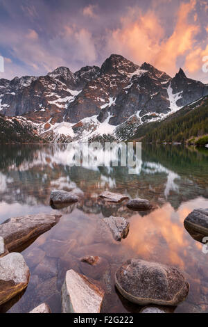 The Morskie Oko mountain lake in the Tatra Mountains in Poland, photographed at sunset. - Stock Photo