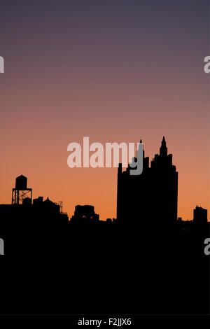 A silhouetted view of the El Dorado building on Manhattan's Upper West Side at sunrise;  New York City, New York - Stock Photo