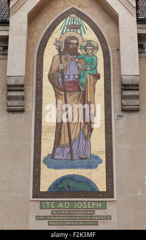 Saint Joseph with the Infant Jesus. Mosaic by the Beuron Art School from 1910 on the Church of Blessed Virgin Mary - Stock Photo