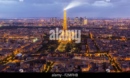 Elevated view of the Eiffel Tower, city skyline and La Defence skyscrapper district in the distance, Paris, France, - Stock Photo