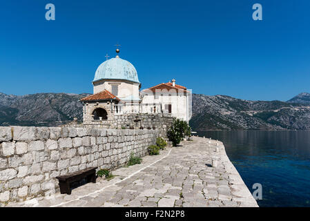 Our Lady of the Rocks church sits on a small man made island in the Bay of Kotor, Perast, Montenegro - Stock Photo