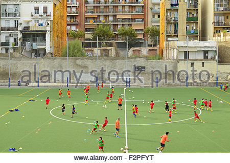Youth football pitch training in Sant Marti district of Barcelona Spain Europe - Stock Photo