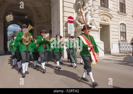Austria festival, a traditional Tyrolean band enters the courtyard of the Hofburg Palace during national harvest - Stock Photo