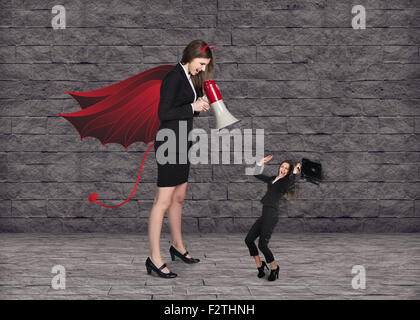 Devil businesslady with a megaphone screeming - Stock Photo