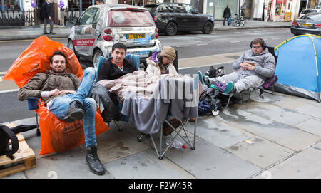 London, UK. 24th September, 2015. Apple fans queue near the Apple Store off Regent Street to be first in line when - Stock Photo