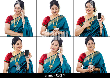 1 indian Marathi adult woman Comparison Mobile Phone Multi Tasking - Stock Photo
