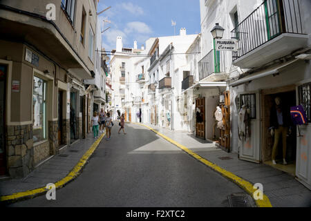 Shoppers in a quiet street in Ibiza Town - Stock Photo