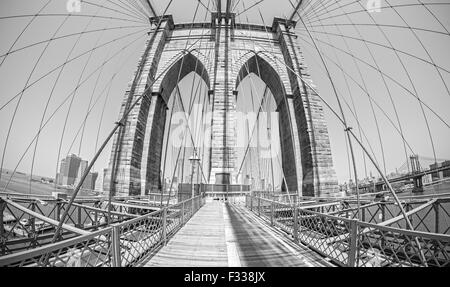 Brooklyn Bridge in fisheye lens, old film black and white style, NYC, USA. - Stock Photo