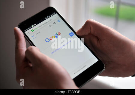 Vodafone Smart Ultra 6 mobile phone showing the new Google logo on it's screen - Stock Photo