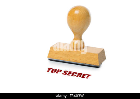 Top Secret printed in red ink with wooden Rubber stamp isolated on white background - Stock Photo