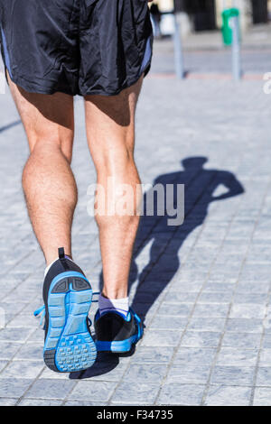 Close up view of athletes legs running - Stock Photo