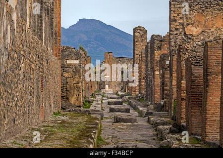View Of Vesuvius From Ruined Street Pompeii Italy - Stock Photo