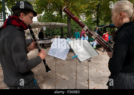 Musicians on the street in front of Dijver during the Brugge Central. Bruges. - Stock Photo