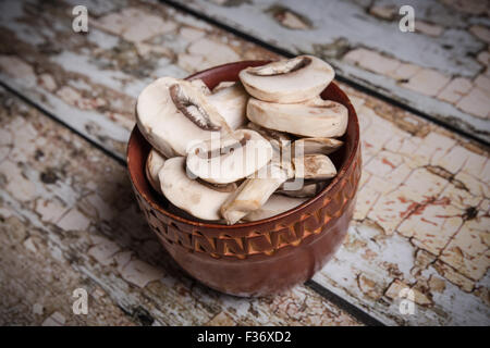 Bowl of sliced button mushrooms with vintage filter - Stock Photo