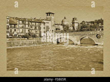 View over the Adige river to old town, Ponte Pietra Bridge and church San Giorgio in Braida, Verona, Veneto, Italy, - Stock Photo