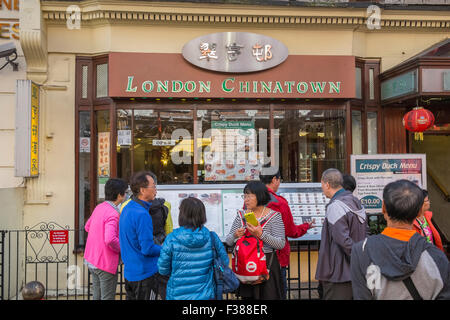 Tourists outside a restaurant in Chinatown, London, England UK - Stock Photo