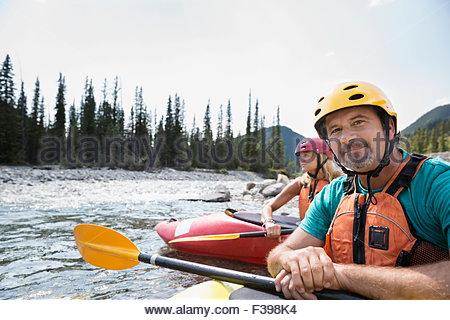 Portrait confident man kayaking in river - Stock Photo
