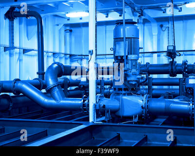 Industrial electric water pump and pipes - industry concept. - Stock Photo