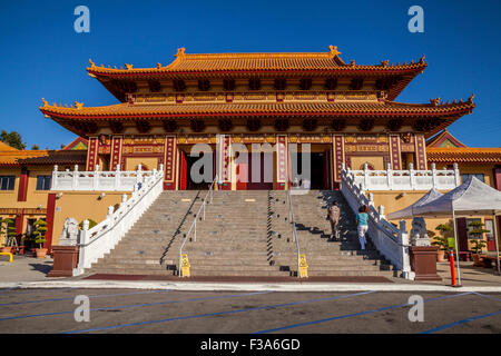 Visitors walking up to the front entrance of the Hsi Lai Buddhist Temple, Hacienda Heights, Los Angeles County, - Stock Photo