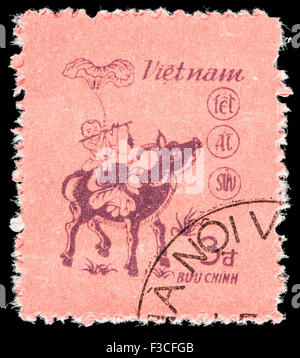 VIETNAM - CIRCA 1985: A postage stamp printed in Vietnam shows a children playing on a buffalo, as on the Dong Ho - Stock Photo