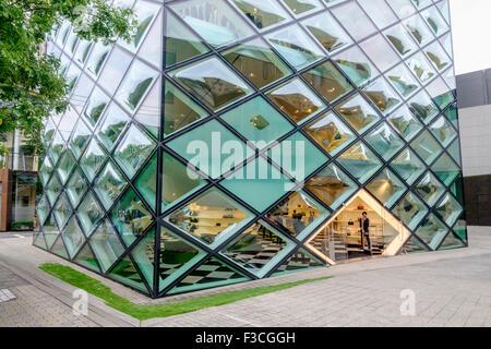 Exterior of glass walled Prada flagship store in Aoyama Tokyo Japan - Stock Photo