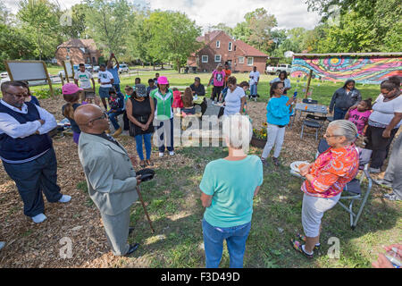 Detroit, Michigan - Members of the Three Mile Block Club dedicate a park they have created where houses were demolished. - Stock Photo