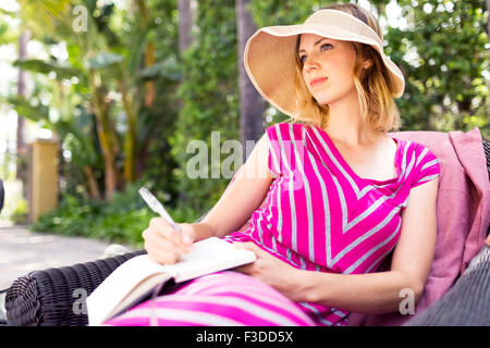 Woman sitting on chair - Stock Photo