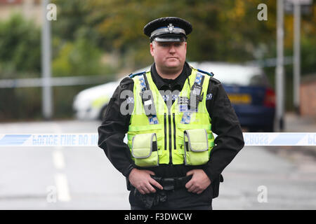 Police guard the scene of a murder in Leeds, West Yorkshire, on October 6th 2015. Police were called to Moorfield - Stock Photo