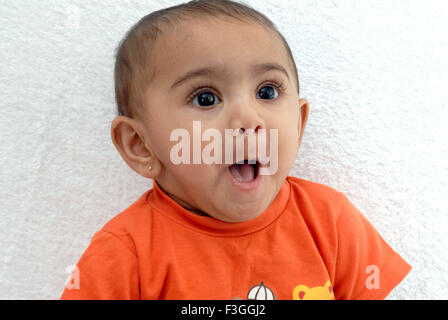 South Asian Indian baby with a naughty expression ; India MR#152 - Stock Photo