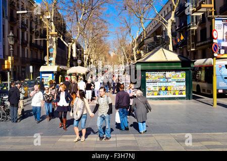 People walking along La Rambla. Barcelona, Catalonia, Spain. - Stock Photo