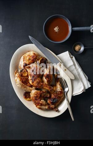 'Day of the Dead' food with roasted chicken and mole poblano sauce - Stock Photo