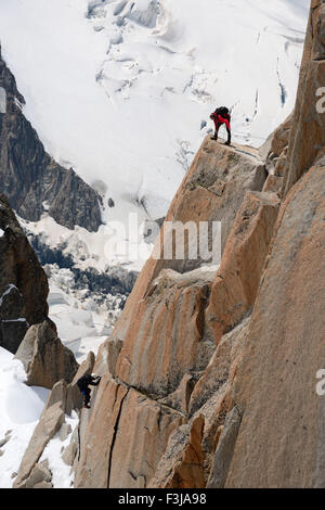 Mountaineers climbing a rock face, Aiguille du Midi, Mont Blanc Massif, Chamonix, French Alps, Haute Savoie, France, - Stock Photo