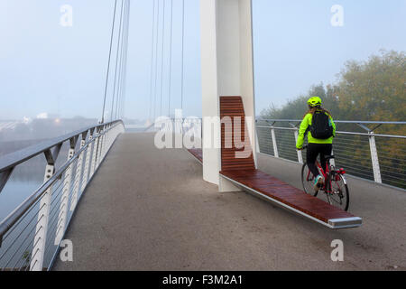 Cyclist on foot and cycle bridge over River Thames, Christchurch Bridge, Reading, Berkshire, England, GB, UK - Stock Photo