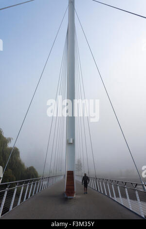 Pedestrian on foot and cycle bridge over River Thames, Christchurch Bridge, Reading, Berkshire, England, GB, UK - Stock Photo